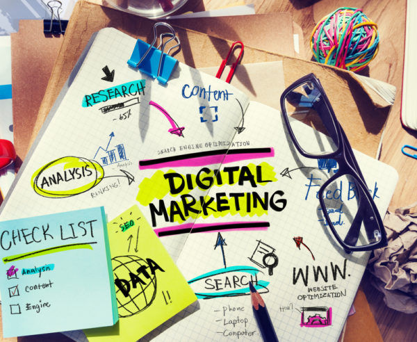 Digital Marketing paper with lots of notes, colourful highlights and tips